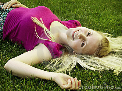 Healthy young girl laying on the grass