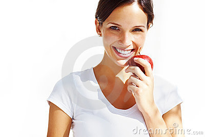 Healthy young lady eating an apple