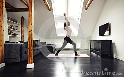 Healthy young lady going yoga workout at home stock photo for Living room yoga timetable