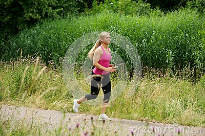 Healthy young woman exercising outdoors