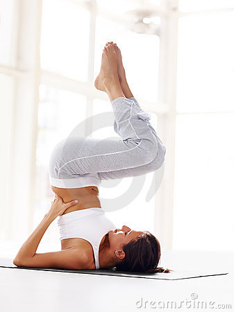 Healthy young woman practising yoga exercise