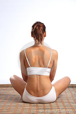 Healthy young womans fit body from behind
