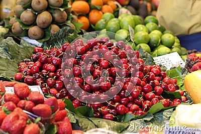 Heap of cherries on market