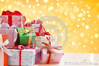 Heap of Christmas gift over blur light
