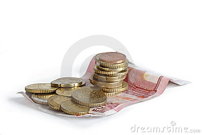 Heap of coins on a banknote.