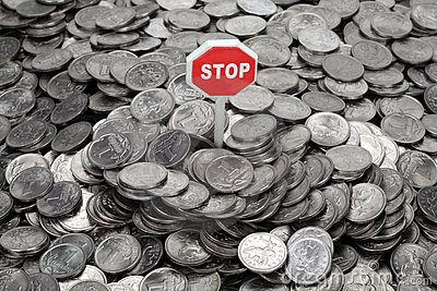 Heap of coins and sign Stop