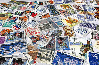 heap of different colorful post stamps, paper
