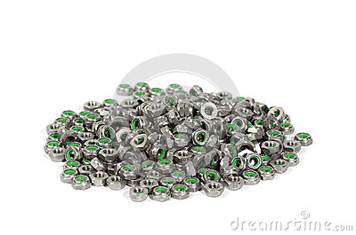 Heap of metal nuts with green interior, stacked, isolated on white