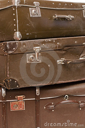 Heap of old suitcases close up