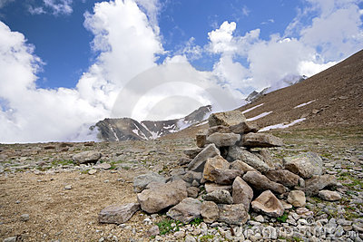 Heap (pyramid) of stones,Caucasus mountains,clouds