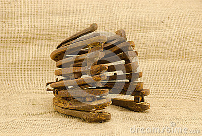 Heap retro rusty horseshoes burlap background
