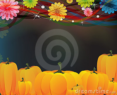 Heap of ripe pumpkins and flowers