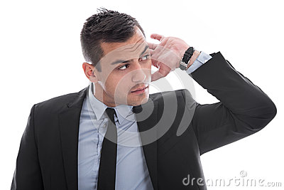 Hearing: attractive young business man listening to isolated on