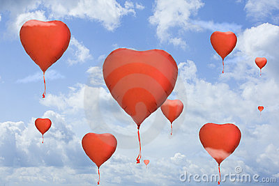 Heart balloons on blue sky