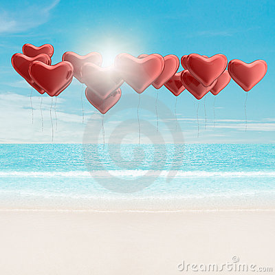 Heart balloons over the sea