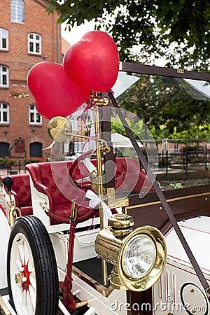 Heart balloons on vintage wedding car