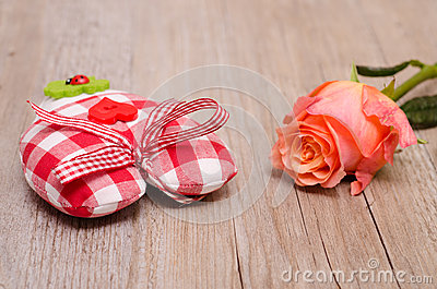 Heart of cloth with flower of a rose