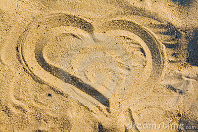 Heart draw on sand