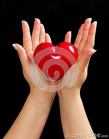 Heart in female hands