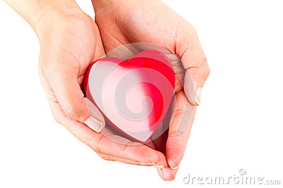 Heart in female hands over white