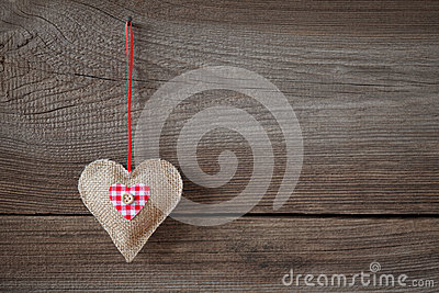Heart hanging on wooden board