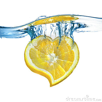 Heart from lemon dropped into water