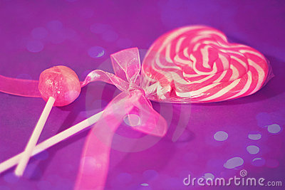 Heart lollipop with pink ribbon and bokeh overlay