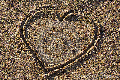 Heart - love sign in sand