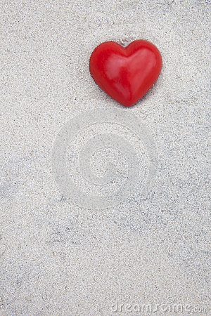 Heart lying in the sand at the beach