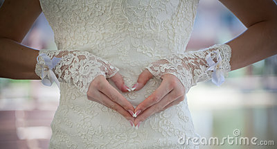 Heart made of brides fingers