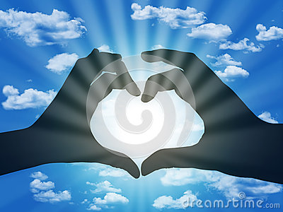 Heart made with fingers on blue sky background