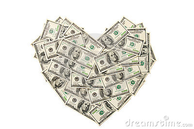 Heart made of hundred dollar banknotes isolated