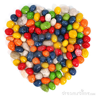 Heart made of multi-coloured sweets with raisin 1