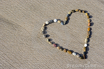 Heart made with small stone in the sand