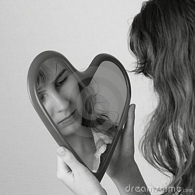 Heart mirror reflecting face of girl