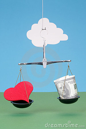 Heart and money on scales