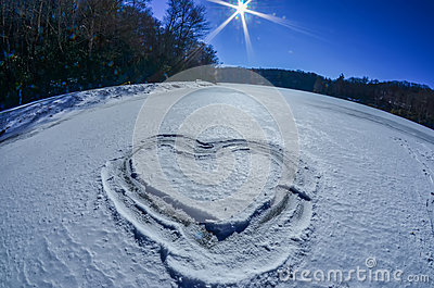 Heart outlined on snow on lake