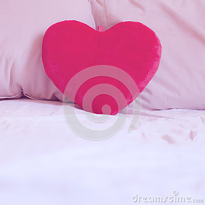 Heart pillow on the bed