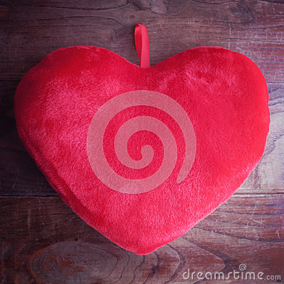 Heart pillow on wood