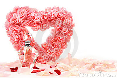 Heart of roses with perfume bottle