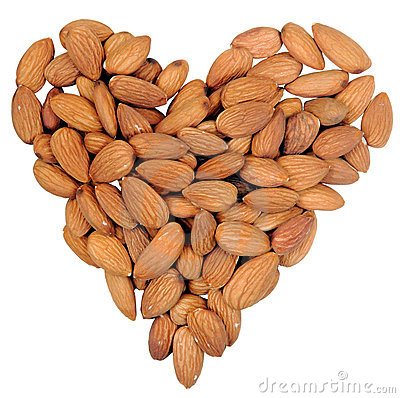 Heart shape from almonds nuts isolated on white.