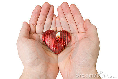 Heart-shape candle in a hands
