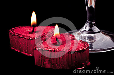 Heart shape candles and wineglass grip