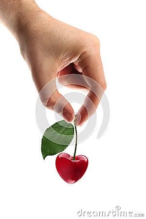 Heart shape cherry in hand