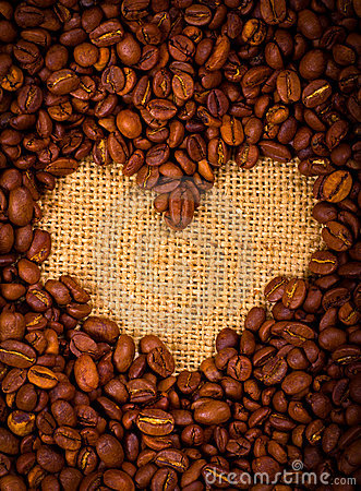 Heart shape created with coffee beans