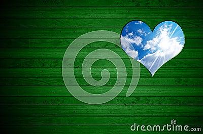Heart Shape cut on Green Wooden Wall