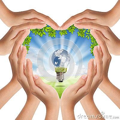 ็Heart shape hands cover nature and light bulb