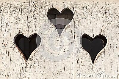 Heart shape look out on wooden door