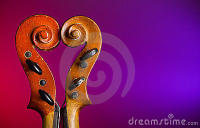 Heart shape make by violin scrolls
