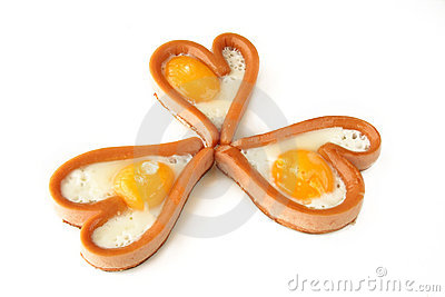 Heart shape sausages with fried eggs